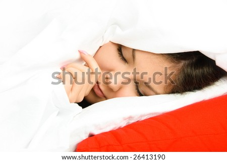 beautiful young brunette woman sleeping peacefully  in her bed at home - stock photo