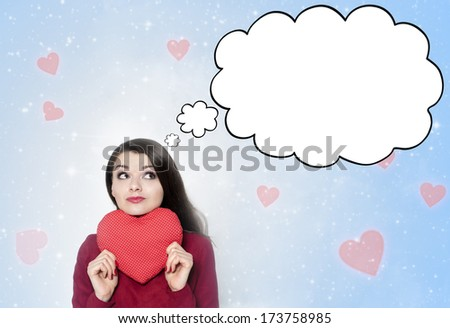 Beautiful young brunette woman thinking about love- valentines portrait - stock photo