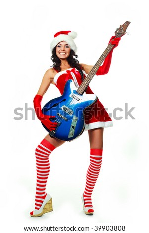 beautiful young brunette woman wearing a Santa's hat and playing a guitar