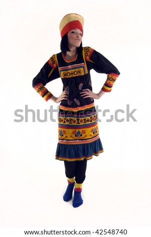 Beautiful young brunette woman wearing russian traditional clothes - stock photo