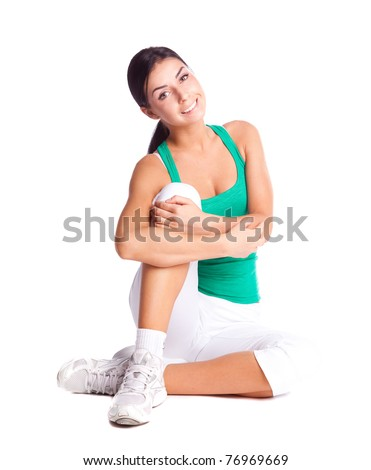 beautiful young brunette woman wearing sports clothes, isolated against white background