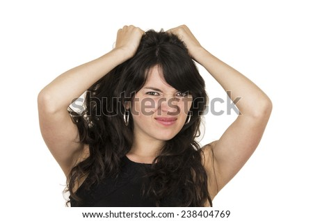 beautiful young brunette woman with black top posing holding hair with hands gesturing anger disappointment isolated on white - stock photo
