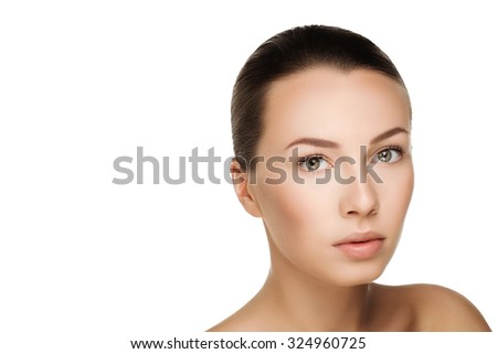 Beautiful young brunette woman with clean fresh skin with nude makeup. Closeup real photo - stock photo