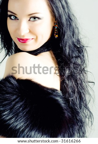 Beautiful young brunette woman with long hair - stock photo