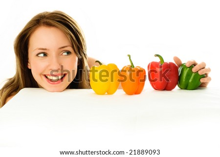beautiful young brunette woman with peppers isolated against white background