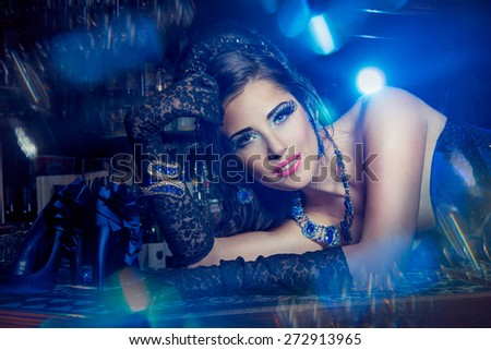Beautiful young burlesque showgirl on stage - stock photo