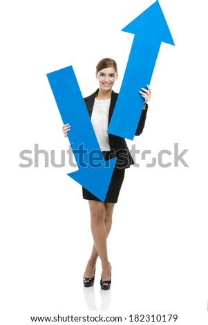 Beautiful young business woman holding a blue arrows, over a white background - stock photo