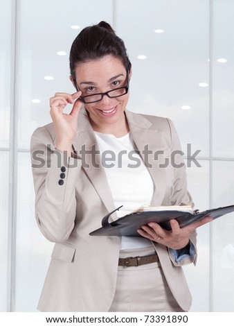 Beautiful young business woman holding a planner