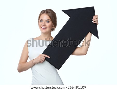 Beautiful young business woman holding black arrows, over a white background - stock photo