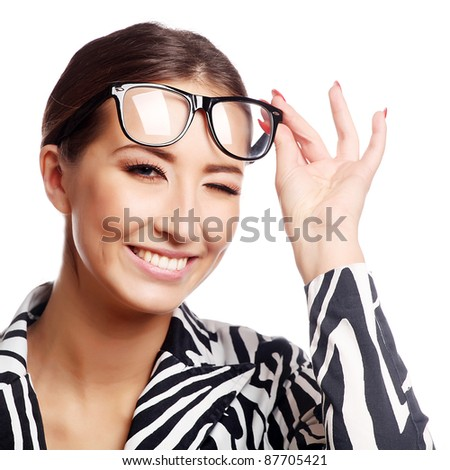 Beautiful young business woman in glasses winking. Isolated over white background - stock photo