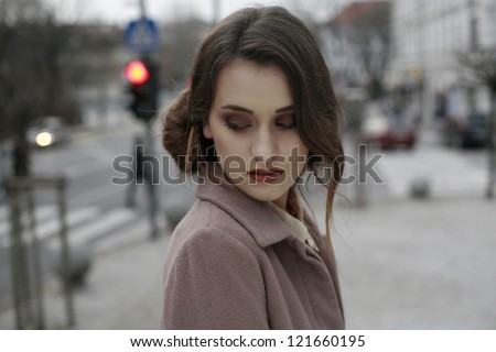 beautiful young business woman in the city looking down