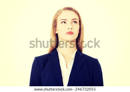 Beautiful young business woman looking up at copy space. - stock photo