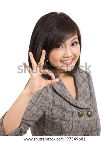 beautiful young business woman making okay gesture - stock photo