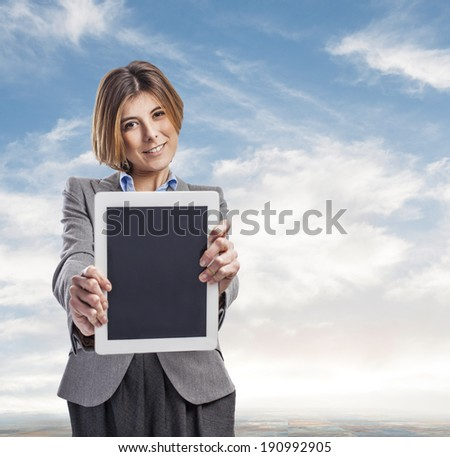 beautiful young business woman showing her tablet
