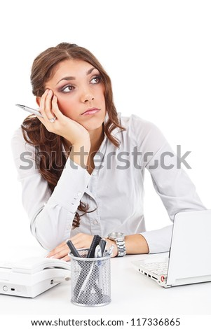 Beautiful young business woman sitting by table - stock photo