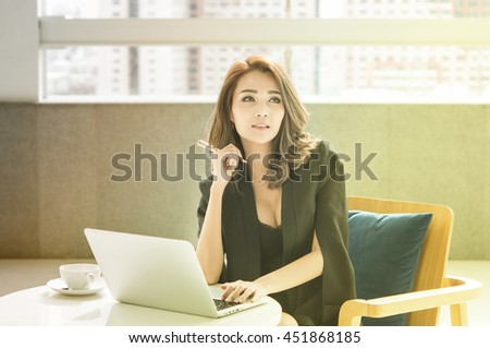 Beautiful young business woman think about his success with happiness,vintage color