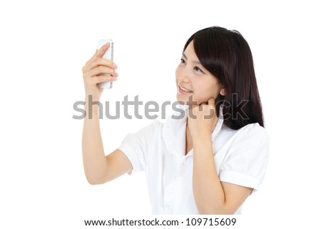 Beautiful young business woman using a mobile phone. Portrait of