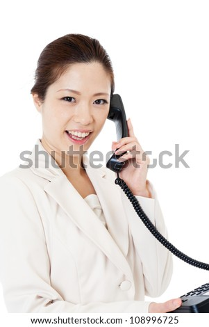 Beautiful young business woman using a telephone. Portrait of as