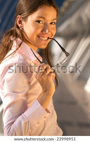 Beautiful young business woman wearing a pink shirt