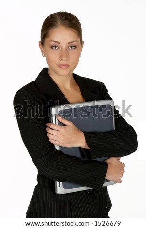 Beautiful Young Business Woman with Arms Folder Around Laptop - stock photo