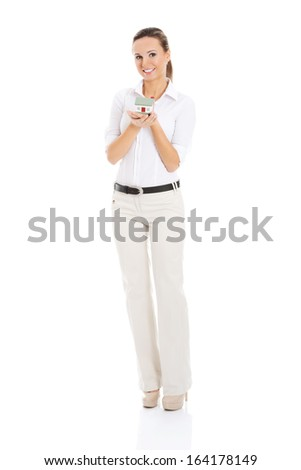 Beautiful young business woman with house on her palm. isolated on white.  - stock photo