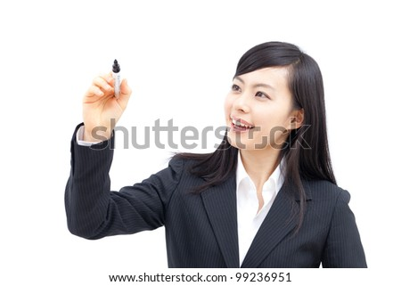 beautiful young business woman writing or drawing something on screen, isolated on white background - stock photo