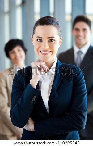 beautiful young businesswoman and team portrait - stock photo