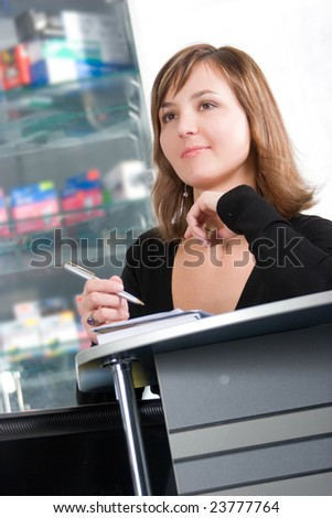 Beautiful young businesswoman at workplace