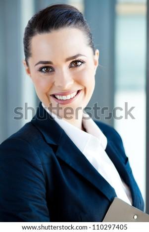beautiful young businesswoman closeup portrait - stock photo