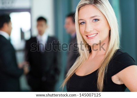 beautiful young businesswoman closeup portrait in office