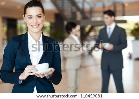 beautiful young businesswoman having coffee break - stock photo