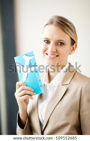 beautiful young businesswoman holding air ticket - stock photo