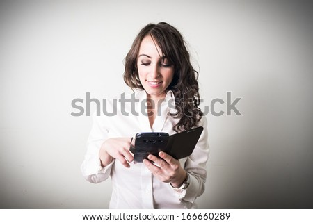 beautiful young businesswoman on gray background - stock photo