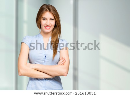 Beautiful young businesswoman portrait in a modern office - stock photo