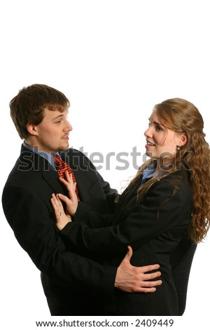 Beautiful young businesswoman refusing sexual advance - stock photo