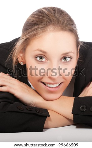 beautiful young businesswoman sitting at the desk, her chin resting on her hands isolated on white background - stock photo