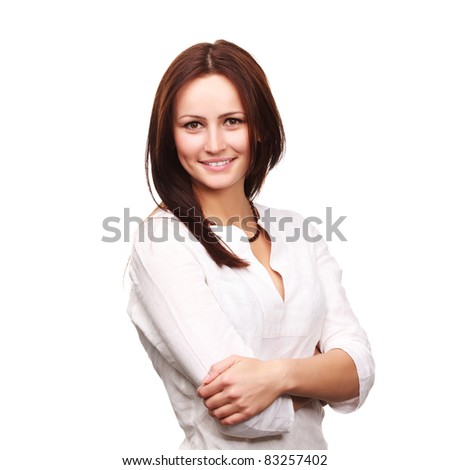 Beautiful young businesswoman standing with hands folded on white background