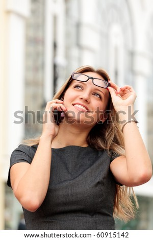beautiful young businesswoman talking by mobile phone - stock photo