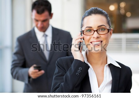 beautiful young businesswoman talking on cell phone