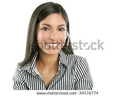 Beautiful young businesswoman talking with headset phone over white background - stock photo