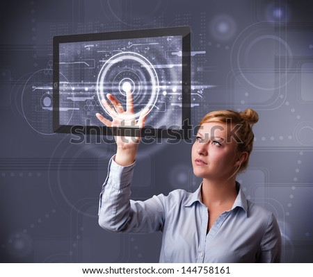 Beautiful young businesswoman touching modern technology tablet - stock photo