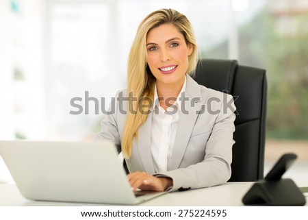 beautiful young businesswoman using computer - stock photo