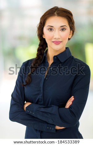 beautiful young businesswoman with arms crossed - stock photo