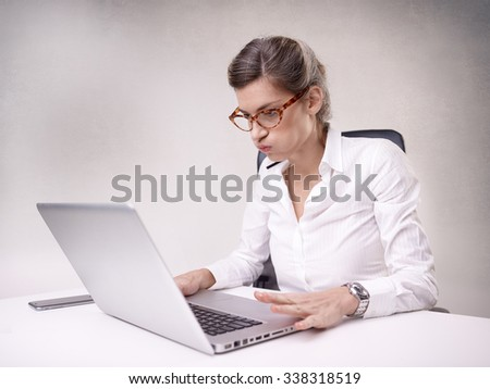 Beautiful young businesswoman working at her desk
