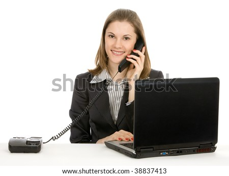 Beautiful young businesswoman working on a laptop. Isolated on white.