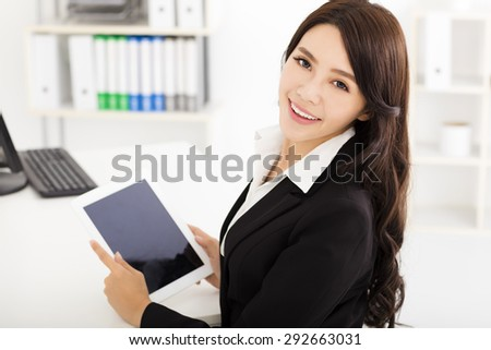 beautiful young businesswoman working with tablet pc - stock photo