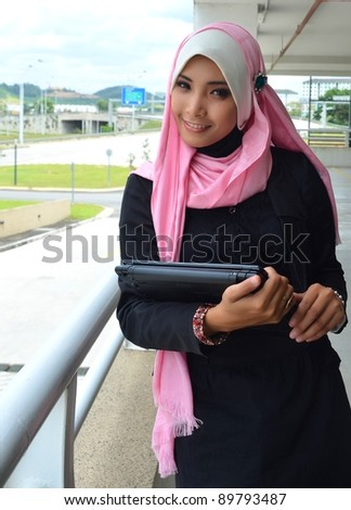 Beautiful young businesswomen smile with laptop. - stock photo