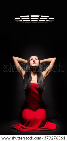 Beautiful young Captive in prison - stock photo