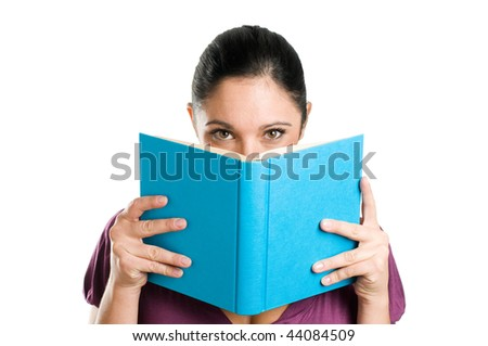Beautiful young casual woman hiding herself behind a book isolated on white background