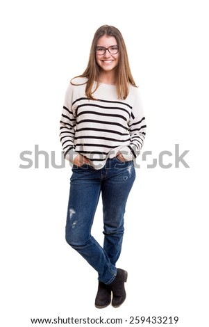 Beautiful young casual woman posing isolated over white - stock photo